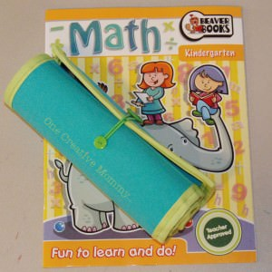 Shows pencil roll with coloring book.