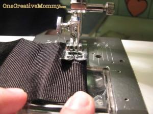 Fold ribbon edge back and stitch it down