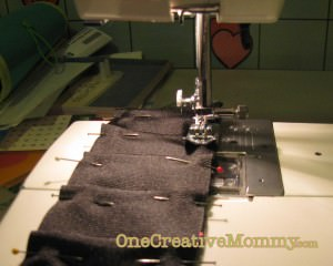 Stitching the pleats to stay in place