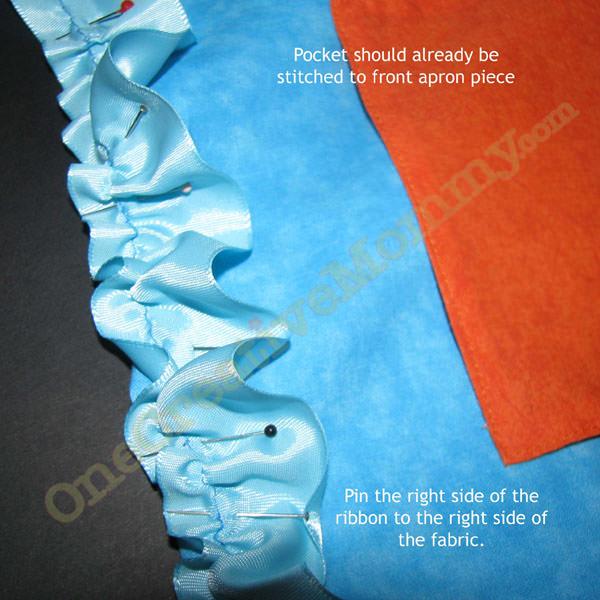 Pin ribbon to edge of apron