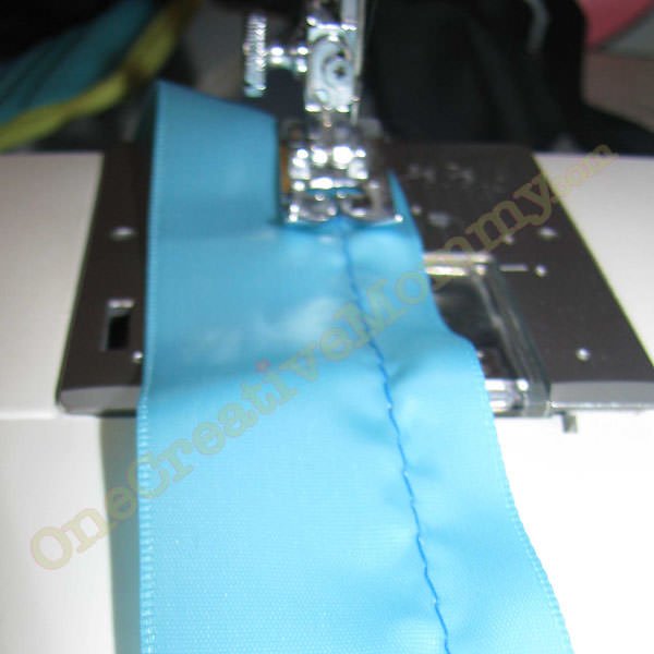 Sew a running stitch along the length of the ribbon