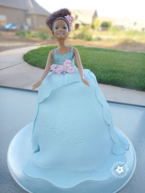 DIY Princess Cake Tutorial -- Use a blond barbie, and you've got an Elsa Frozen Cake! {Tutorial from OneCreativeMommy.com}