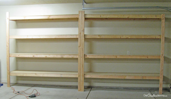 The garage is so much more organized with these new storage shelves! Love them! {OneCreativeMommy.com}