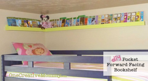 DIY Pocket/Front-Facing Bookshelves for Bunk Beds {OneCreativeMommy.com}  Keep the books off the floor and right where the kids can find them!  #bookshelf #organization