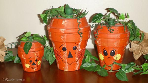 Terra Cotta Pumpkins before the makeover {OneCreativeMommy.com} Fall Decor