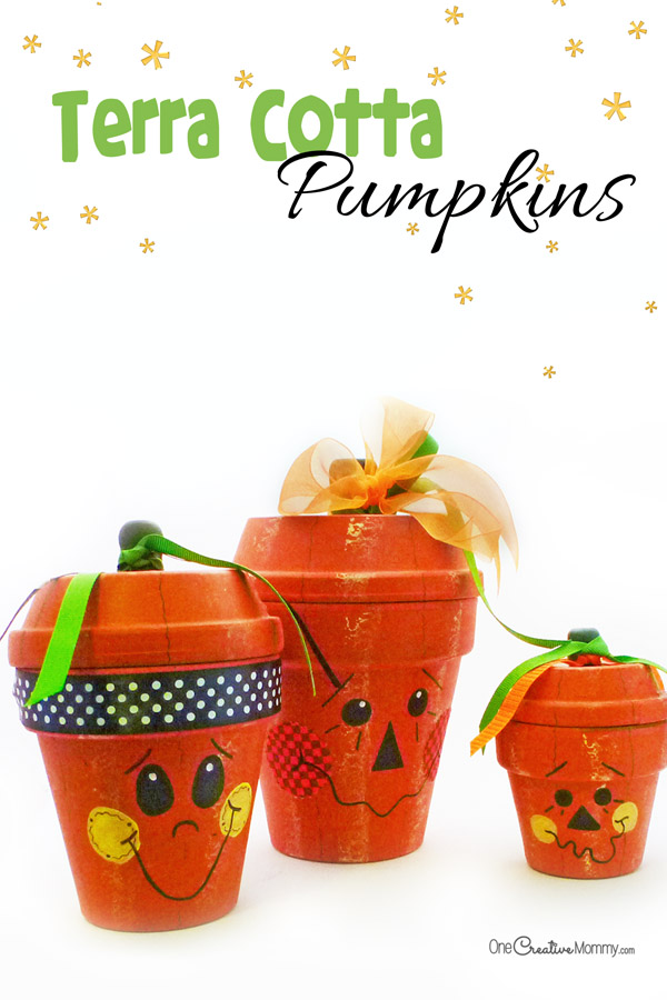 Love these cute Terra Cotta Pumpkins! Use them as Jack O'Lanterns for Halloween, or turn them around for plain pumpkins for Fall. {OneCreativeMommy.com}