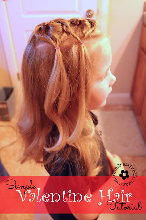 Create this easy Valentine hair style in ten minutes or less! I'll show you how. {Valentines Day heart hair style for little girls on OneCreativeMommy.com} #valentinehair #hairforgirls #littlegirlshair #valentinesday