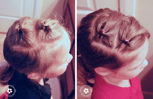 Step 2 to create an easy Valentine hair style in ten minutes or less! I'll show you how. {OneCreativeMommy.com} #valentinehair #hearthair