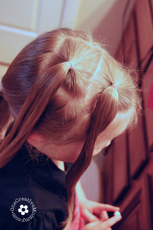 Create this easy Valentine hair style in ten minutes or less! I'll show you how. {Valentines Day heart hair style for little girls on OneCreativeMommy.com} width=