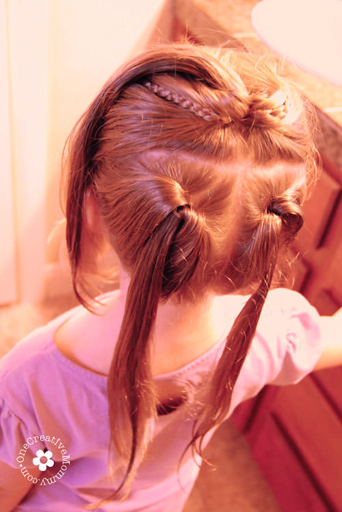 Learn how to create this adorable shamrock hair style for St. Patrick's Day with this simple tutorial from OneCreativeMommy.com {Step 2}