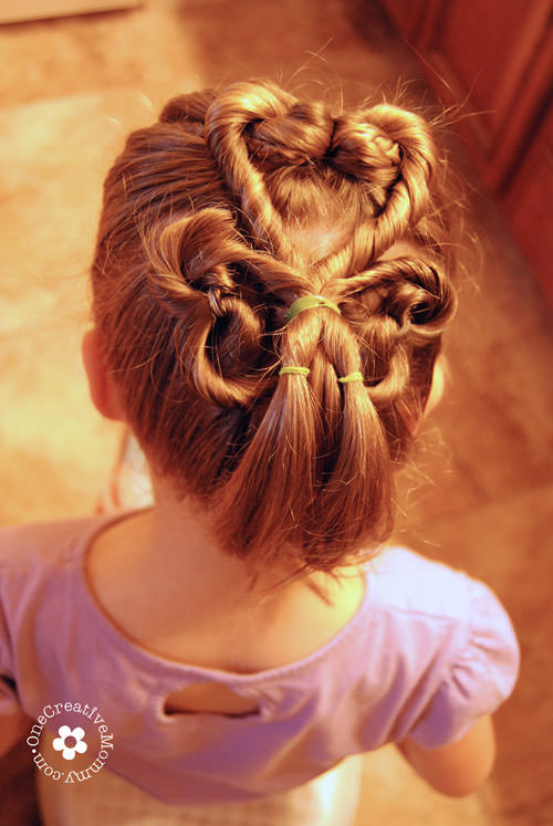 Learn how to create this adorable shamrock hair style for St. Patrick's Day with this simple tutorial from OneCreativeMommy.com {Step 6}