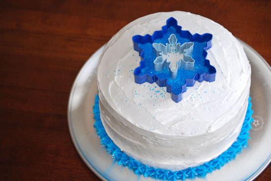 Easiest Ever Disney Frozen Birthday Cake! {OneCreativeMommy.com} Process Step 4 #frozenparty #frozen #birthdaycakes