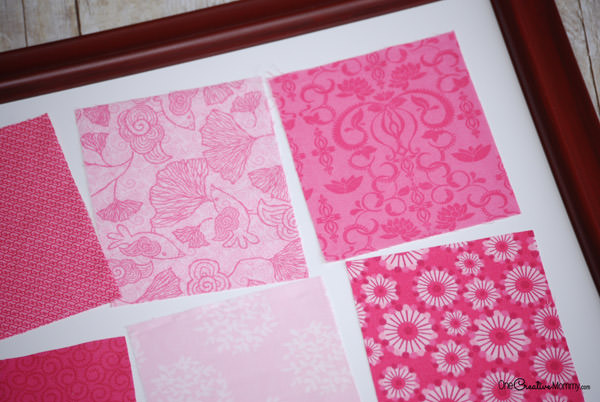 Is your house looking drab? Grab some fabric scraps and an old frame, and check out my tutorial to create these Easy Valentine Decorations! {OneCreativeMommy.com} No sewing. Seriously. This is so easy!