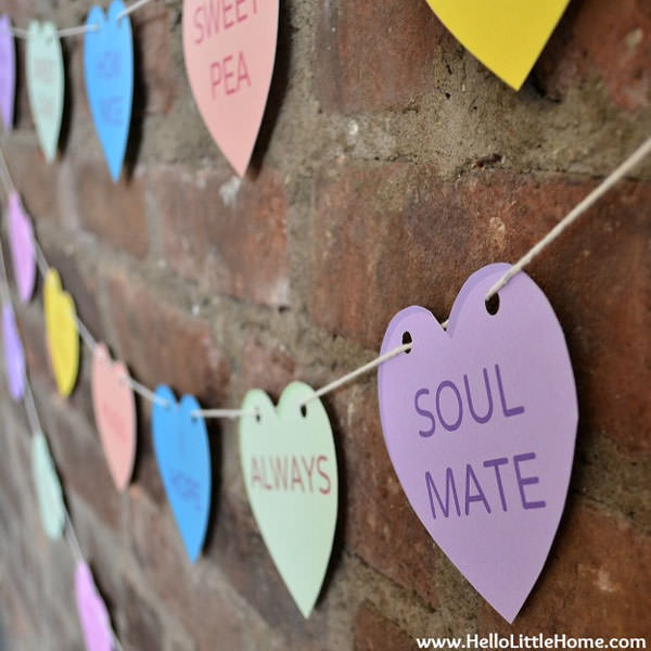 {Conversation Heart Banner with Printables} One of 25+ Cute Valentine Crafts for Kids rounded up on OneCreativeMommy.com {Come see them all and visit and pin your favorites}