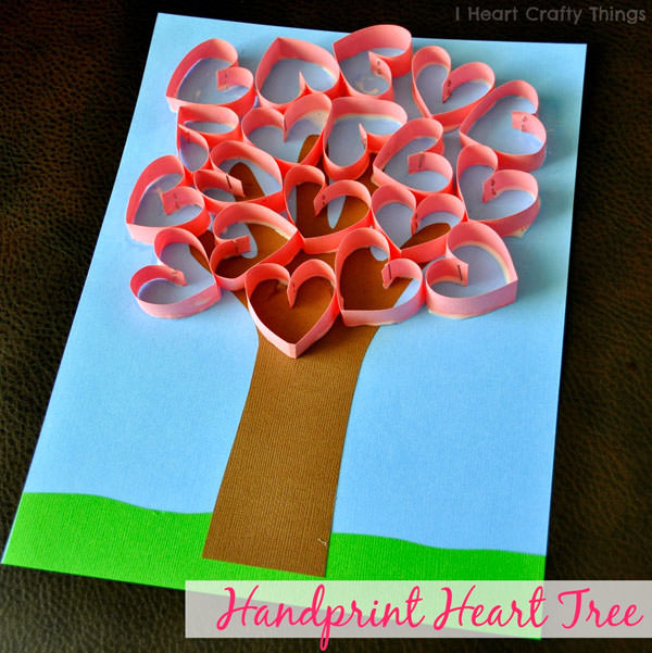 {Handprint Heart Tree} One of 25+ Cute Valentine Crafts for Kids rounded up on OneCreativeMommy.com {Come see them all and visit and pin your favorites}