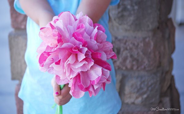 These gorgeous paper flowers are simple and cheap to make. {Easy Coffee Filter Flowers Tutorial from OneCreativeMommy.com}