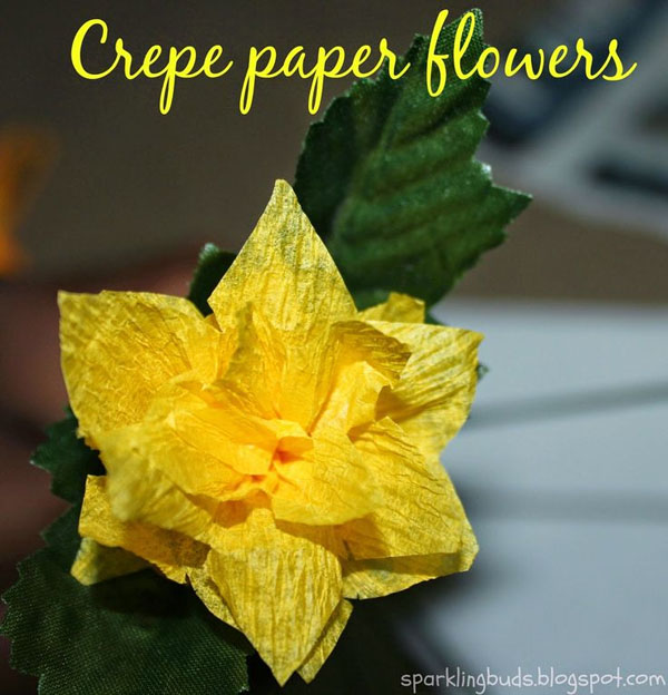 Crepe Paper Daffodil tutorial from Sparkling Buds Vibrant Coffee Filter Flowers Tutorial from Fun at Home with Kids {Featured on OneCreativeMommy.com} 19 Best Paper Flower Tutorials