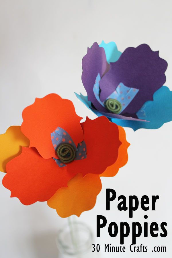 Paper Poppy Craft from 30 Minute Crafts Vibrant Coffee Filter Flowers Tutorial from Fun at Home with Kids {Featured on OneCreativeMommy.com} 19 Best Paper Flower Tutorials