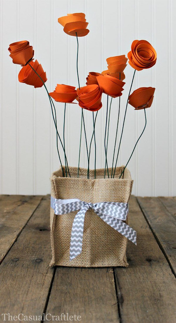 Paper Roses and Burlap Vase Holder from The Casual Craftlete Vibrant Coffee Filter Flowers Tutorial from Fun at Home with Kids {Featured on OneCreativeMommy.com} 19 Best Paper Flower Tutorials