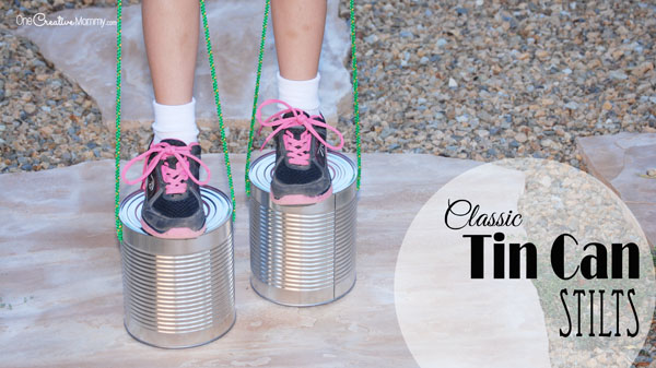 Keep kids active during the quarantine with homemade Tin Can Stilts! {OneCreativeMommy.com} I remember playing with these when I was a kid!