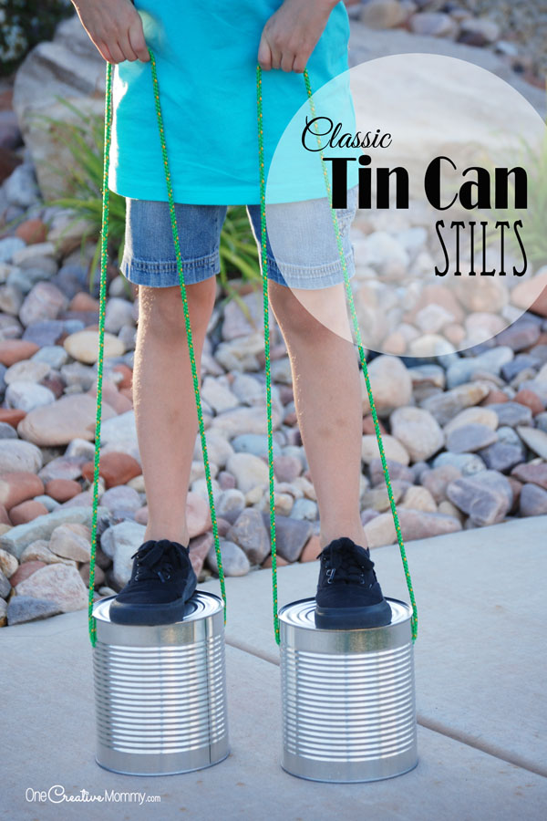Just in time for summer, recycle tin cans into a classic toy -- Tin Can Stilts! {OneCreativeMommy.com} I remember playing with these when I was a kid!
