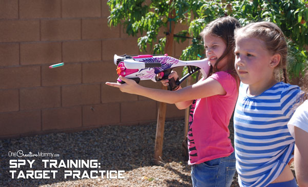 A Nerf gun is perfect for target practice at Spy Training Camp! {OneCreativeMommy.com}