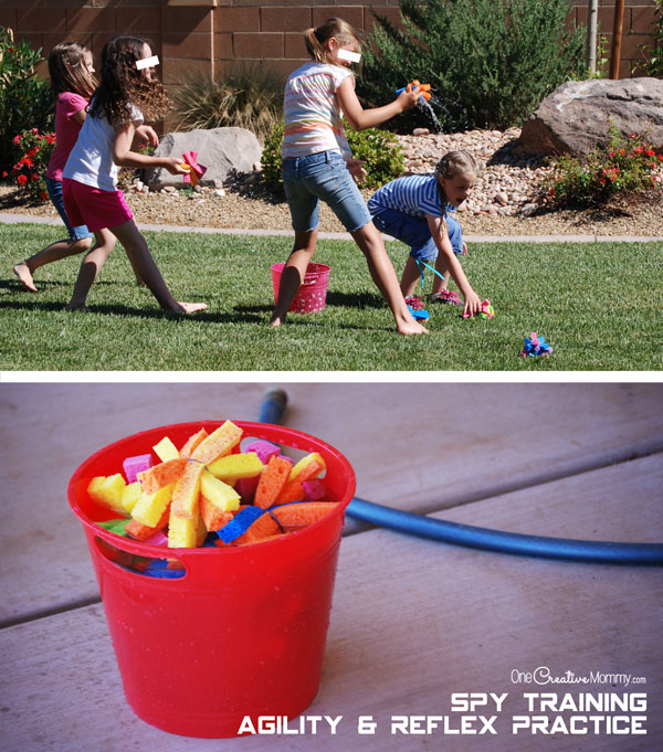 Spies test their agility and quick reflexes with a fun water bomb fight {OneCreativeMommy.com} Cool spy party ideas!