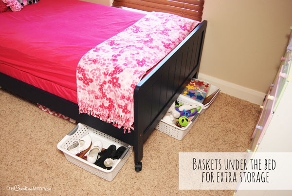 Small Space Living -- Baskets under the bed keep the space neat and the objects accessible. No more under the bed nightmare! {OneCreativeMommy.com}