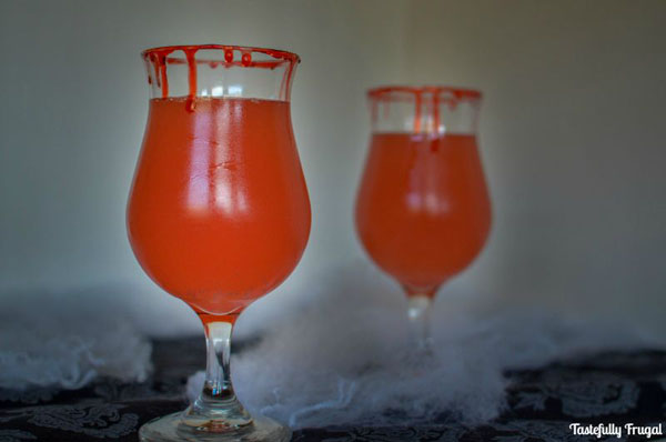 Spook up your Halloween Party with this fun Dracula Punch! | Halloween Party Idea from Tastefully Frugal on Spooktastic September {OneCreativeMommy.com}