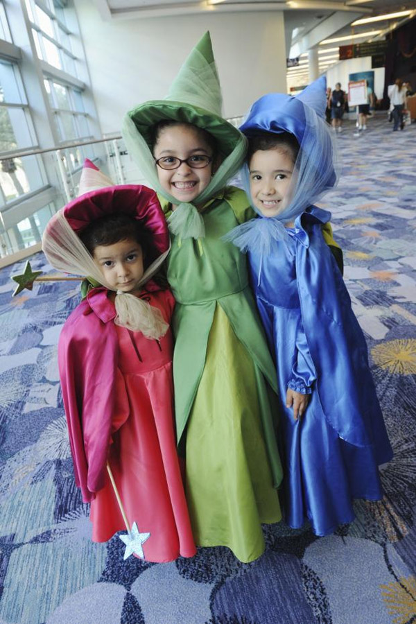 Flora, Fauna and Merryweather make a perfect costume idea for sisters! {Featured on OneCreativeMommy.com's Couple's and Family Halloween Costume Roundup}