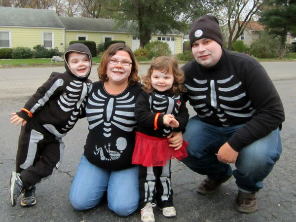 Look closely at Mom's t-shirt in this fun family skeleton Halloween costume idea! {Featured on OneCreativeMommy.com's Couple's and Family Halloween Costume Roundup}