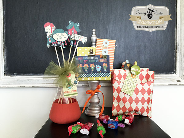 Use adorable Monsters scrapbook paper to create this cute Halloween decor and these fun treat bags! {Jodi of Fancy Pants Designs on OneCreativeMommy.com} Cool Halloween Ideas!