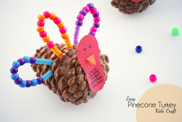 This pinecone turkey craft is perfect for kids learning patterns or just for fun! {OneCreativeMommy.com} Great Thanksgiving craft for preschool and kindergarten