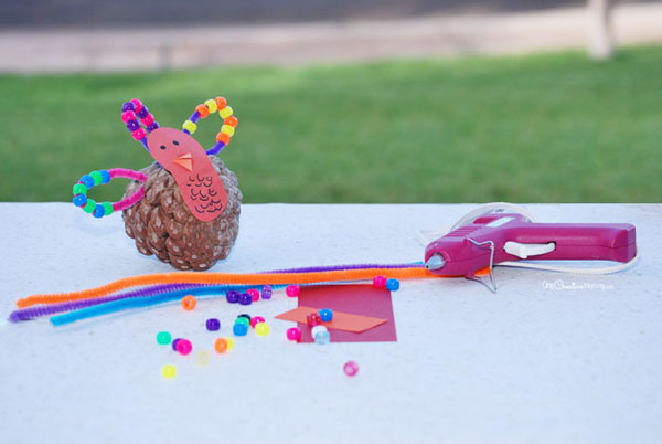 Materials for pinecone turkey craft {OneCreativeMommy.com}