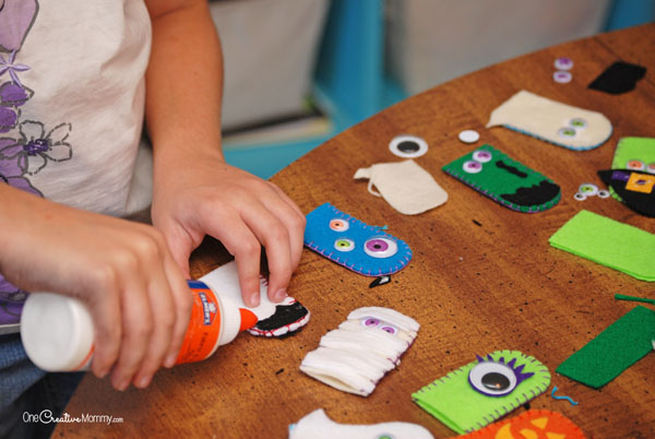Fun Felt Halloween Finger Puppets! {OneCreativeMommy.com} The fun part! Designing the monsters!