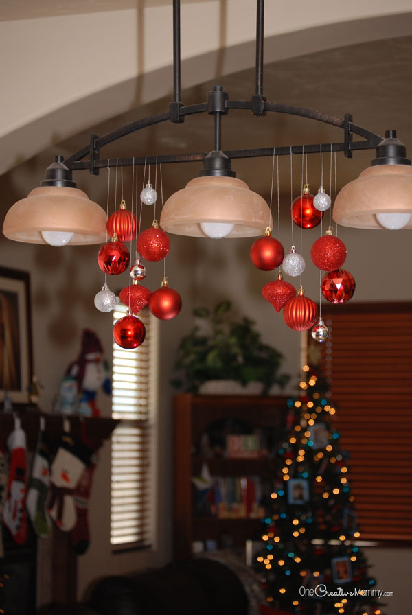 Turn an ordinary light fixture into a beautiful Christmas chandelier in just a few minutes! {OneCreativeMommy.com} This is the easiest Christmas decor ever!