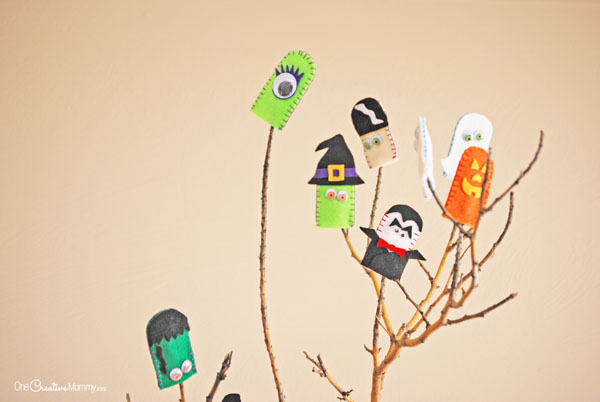 Turn an ordinary branch into fun Halloween decor! {OneCreativeMommy.com}