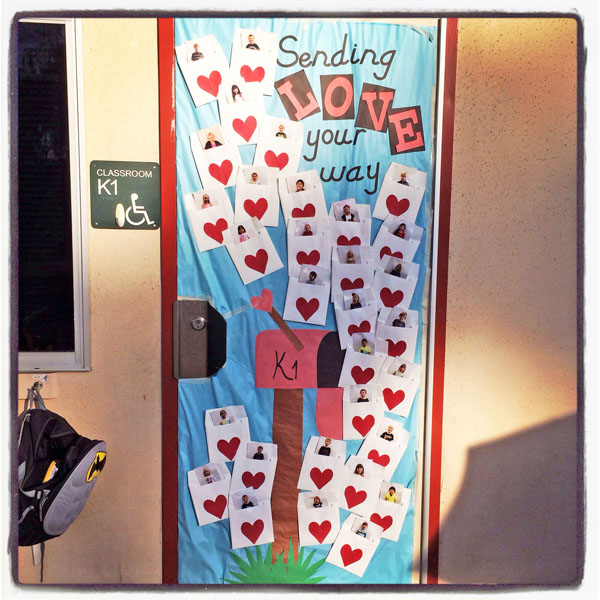 Sending Love Your Way - Featured in 27 Valentine's Day Classroom Door Decorating Ideas {OneCreativeMommy.com}