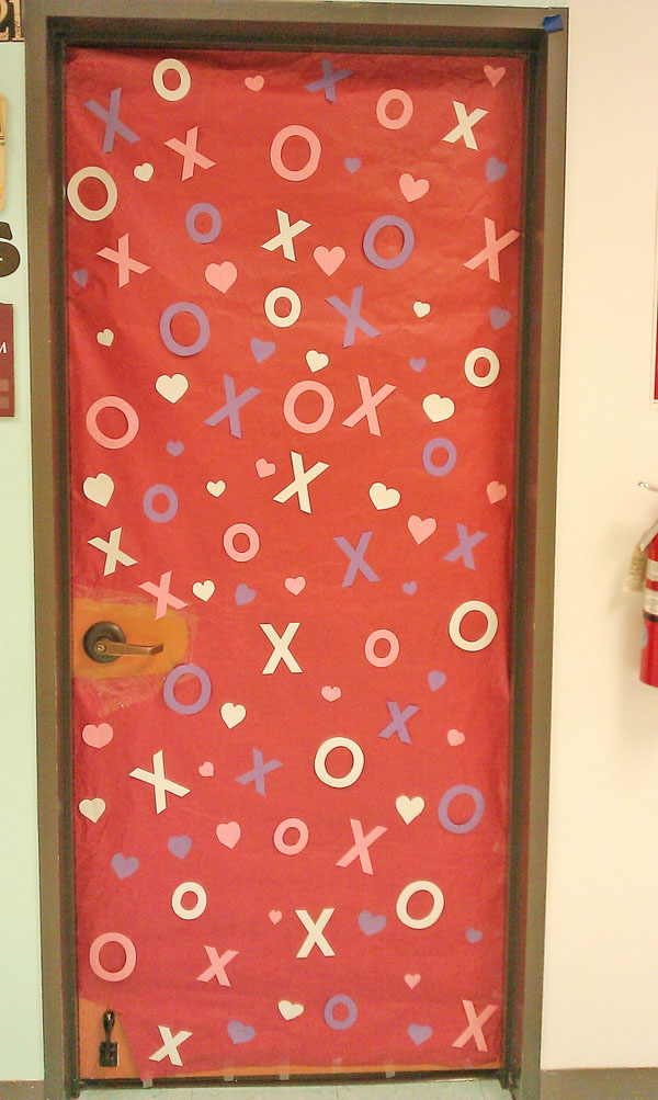 Hugs and Kisses Classroom Door - Featured in 27 Valentine's Day Classroom Door Decorating Ideas {OneCreativeMommy.com}