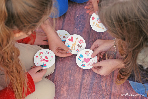 If you love the Spot It card game, then you'll love this Valentine's Day matching game, too! {OneCreativeMommy.com} Free Printables #spotit #printable #valentinesday #valentinesdaygame #familyfun #familynight