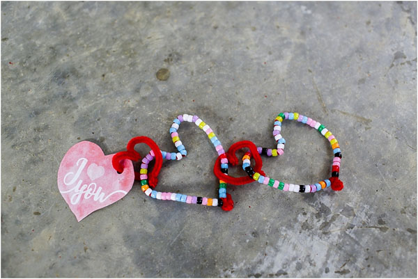Bead Stringing Toddler Craft from Sixth Bloom Featured on 25 amazing Valentine craft ideas to try right now! {OneCreativeMommy.com}