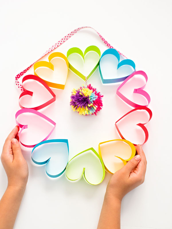 Paper Heart Wreath from Hello Wonderful Featured on 25 amazing Valentine craft ideas to try right now! {OneCreativeMommy.com}