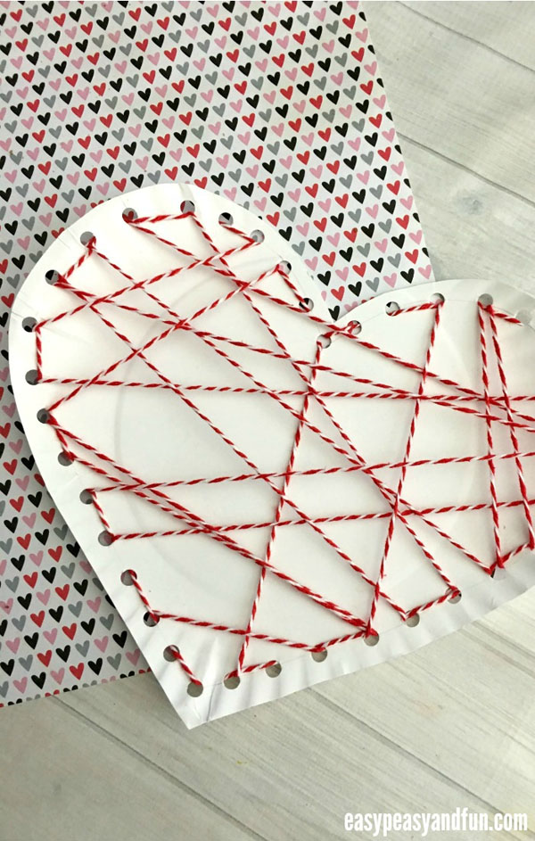 Threaded Heart Paper Plate Craft from Easy Peasy and Fun Featured on 25 amazing Valentine craft ideas to try right now! {OneCreativeMommy.com}