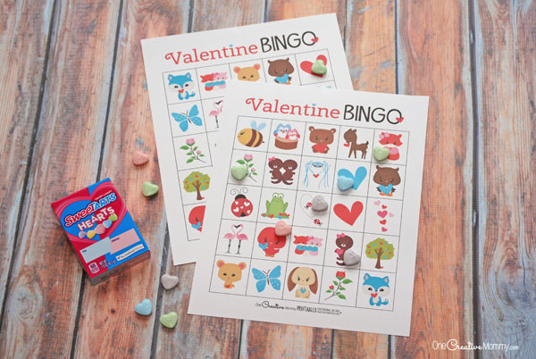This printable Valentine Bingo game is the cutest! I can't wait to play it with my kids. {OneCreativeMommy.com} Class Party Set and Family Set #valentinesday #valentinesdaygames #valentinesdaypartyideas #bingo #printable