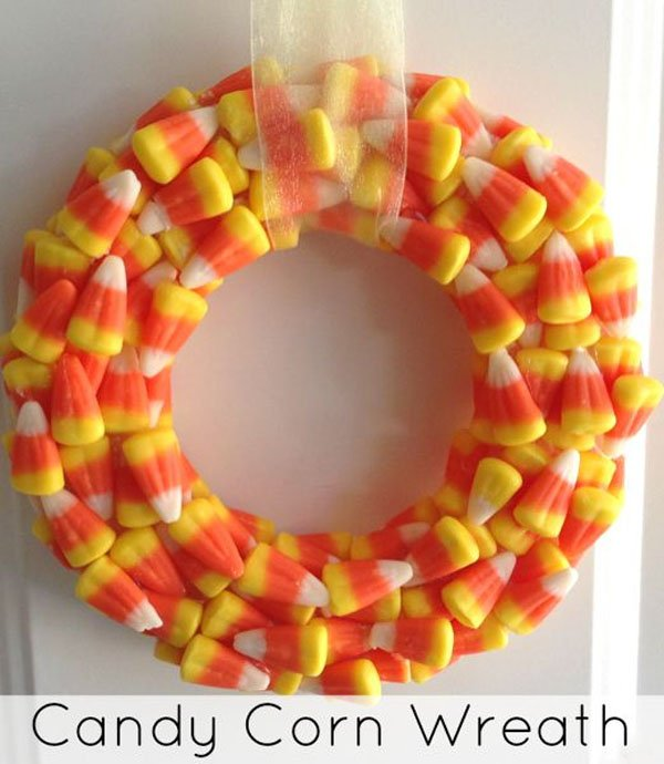 DIY Candy Corn Wreath from the Jenny Evolution | Featured in 19 Easy Halloween Wreaths you can actually make {OneCreativeMommy.com}
