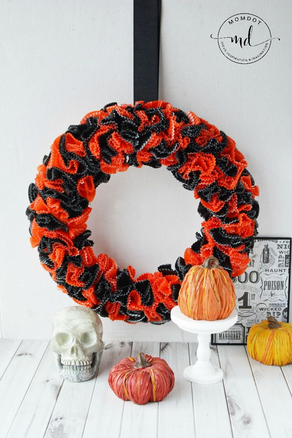How to Make a Cupcake Liner Wreath from MomDot | Featured in 19 Easy Halloween Wreaths you can actually make {OneCreativeMommy.com}