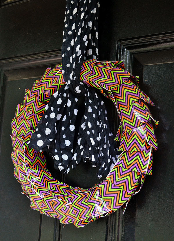 Duct Tape Halloween Wreath from Burlap and Blue | Featured in 19 Easy Halloween Wreaths you can actually make {OneCreativeMommy.com}