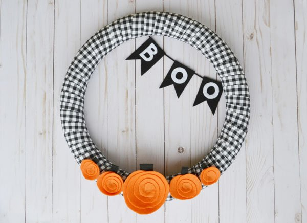 Five Little Pumpkins Halloween Wreath from Mary Martha Mama | Featured in 19 Easy Halloween Wreaths you can actually make {OneCreativeMommy.com}
