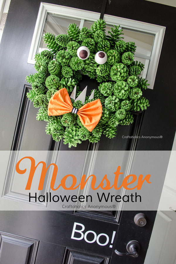Monster Halloween Wreath from Craftaholics Anonymous | Featured in 19 Easy Halloween Wreaths you can actually make {OneCreativeMommy.com}