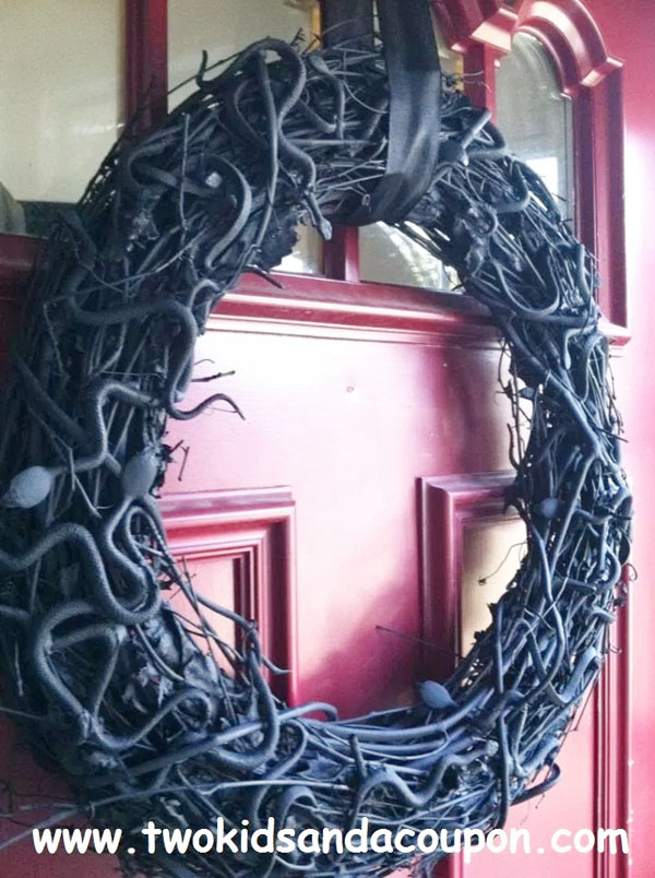 How to Make a Spooky Snake Wreath for Halloween from Two Kids and a Coupon | Featured in 19 Easy Halloween Wreaths you can actually make {OneCreativeMommy.com}